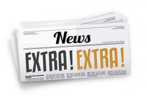 Newspaper with headline Extra! Extra!
