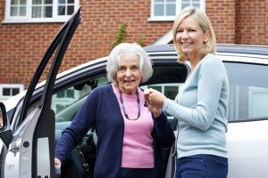 Female Giving Senior Woman A Lift In Car