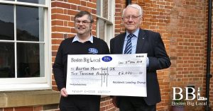 Richard Tory presenting a cheque to Richard Austin