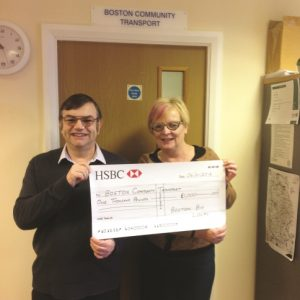 Richard Tory, Chair of Boston Big Local presents a cheque to Gill Williamson of Boston Community Transport