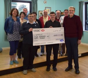 Boston Big Local Chair presents a large cheque for £440 to the Smylle Support Group
